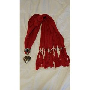Red scarf with silver heart pendant